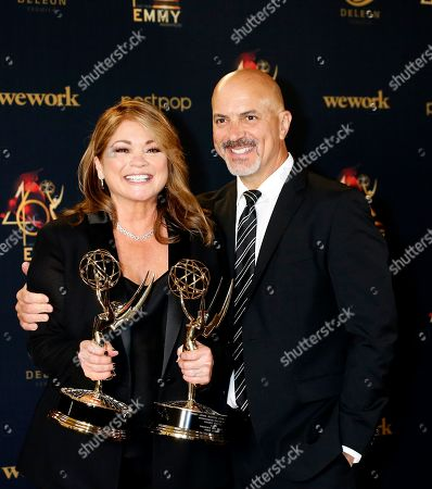 Valerie Bertinelli (L) poses with husband Tom Vitale (R) while holding her Daytime Emmy Awards in the pressroom after winning for 'Outstanding Culinary Program' and 'Outstanding Culinary Host' during the 46th annual Daytime Emmy Awards at the Pasadena Civic Center in Pasadena, California, USA, 05 May 2019.