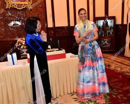 Stock Image of Crown Princess Victoria receives gift from Vice President of Vietnam Mrs. Dang Thi Ngoc Thinh in Hanoi