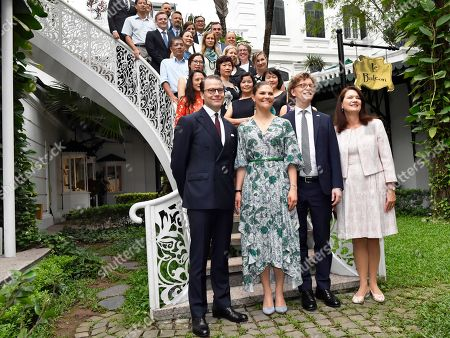 Prince Daniel, Crown Princess Victoria, Sweden's Ambassador to Vietna Pereric Hogberg and Minister for Foreign Trade Ann Linde and the staff of the Ambassy in Hanoi