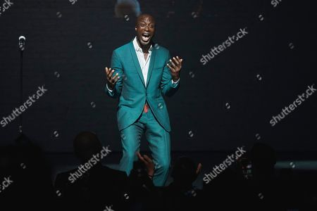 Ozwald Boateng salutes the public during his fashion show at Apollo Theater in New York