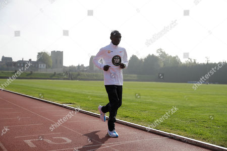 Marathon world record holder Kenya's Eliud Kipchoge poses for photographers by crossing the finish line at the Iffley Road Track, in Oxford, England, where in 1954 British athlete Roger Bannister ran to become the first person ever to break the four minute mile barrier. Eliud Kipchoge has funding from Britain's richest man, Jim Ratcliffe, who founded chemicals group INEOS, for his bid to break the two-hour marathon barrier again later this year