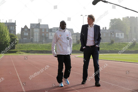 Marathon world record holder Kenya's Eliud Kipchoge and Britain's richest person Jim Ratcliffe walk for photographers at the Iffley Road Track, in Oxford, England, where British athlete Roger Bannister, in 1954 ran to become the first person ever to break the four minute mile barrier. Eliud Kipchoge has funding from Britain's richest man, Jim Ratcliffe, who founded chemicals group INEOS, for his bid to break the two-hour marathon barrier again later this year