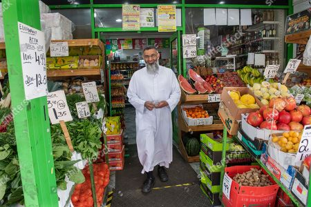Anjem Choudary leaves his local supermarket near his home in East London.