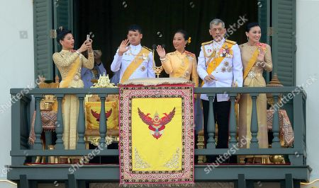 King Maha Vajiralongkorn, Queen Suthida. Thailand's royal family from left; Princess Sirivannavari Nariratana, daughter, takes a photo, of the royal family from second left; Prince Dipangkorn Rasmijoti, son, Princess Bajrakitiyabha, daughter, King Maha Vajiralongkorn and Queen Suthida wave to an audience from the balcony of Suddhaisavarya Prasad Hall in the Grand Palace during the coronation ceremony, in Bangkok, Thailand. Vajiralongkorn was officially crowned amid the splendor of the country's Grand Palace, taking the central role in an elaborate centuries-old royal ceremony that was last held almost seven decades ago
