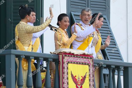 Maha Vajiralongkorn, Suthida, Sirivannavari Nariratana, Dipangkorn Rasmijoti, Bajrakitiyabha. Thailand's royal family from left; Princess Sirivannavari Nariratana, daughter, Prince Dipangkorn Rasmijoti, son, Princess Bajrakitiyabha, daughter, King Maha Vajiralongkorn and Queen Suthida wave to an audience from the balcony of Suddhaisavarya Prasad Hall in the Grand Palace during the coronation ceremony, in Bangkok, Thailand. Vajiralongkorn was officially crowned amid the splendor of the country's Grand Palace, taking the central role in an elaborate centuries-old royal ceremony that was last held almost seven decades ago