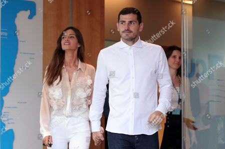 Spanish goalkeeper Iker Casillas, with his wife Sara Carbonero, leaves a hospital in Porto, Portugal, . Veteran goalkeeper Iker Casillas had a heart attack during a training session with his Portuguese club FC Porto and was hospitalized May 1