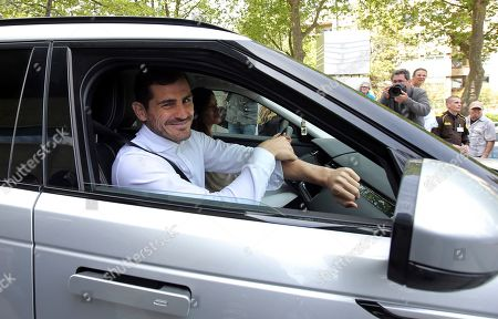 Spanish goalkeeper Iker Casillas smiles as he and his wife Sara Carbonero leave a hospital in Porto, Portugal, . Veteran goalkeeper Iker Casillas had a heart attack during a training session with his Portuguese club FC Porto and was hospitalized May 1