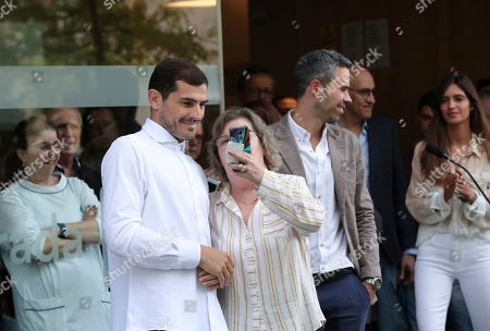 Spanish goalkeeper Iker Casillas poses for a picture outside a hospital in Porto, Portugal, . Veteran goalkeeper Iker Casillas had a heart attack during a training session with his Portuguese club FC Porto and was hospitalized May 1