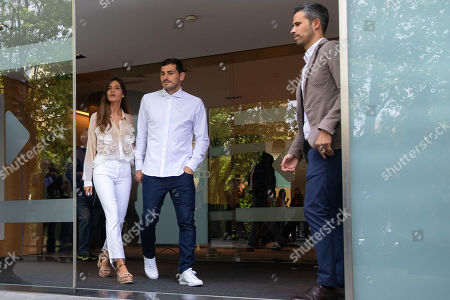 Stock Photo of FC Porto's Spanish goalkeeper Iker Casillas (C) and his wife Sara Carbonero (L) leave the CUF Hospital in Porto, Portugal, 06 May 2019. Casillas was hospitalized since 01 May 2019 after suffering a heart attack during his team's training session.