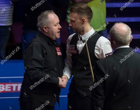 Judd Trump of England shakes hands with John Higgins of Scotland after winning the final match