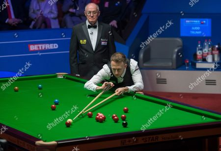 Stock Photo of Judd Trump of England at the table during the final match