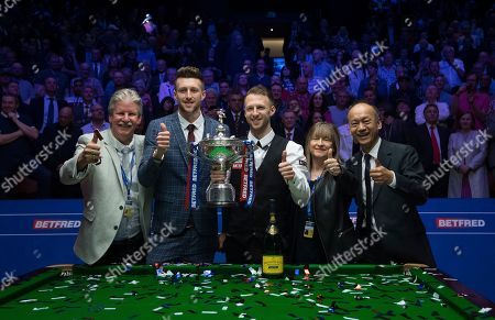 Stock Picture of Judd Trump of England celebrates winning the final match with his father Steve, brother Jack, mother Georgina and his manager Django Fung