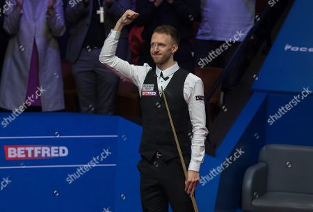 Stock Image of Judd Trump of England celebrates winning the final match