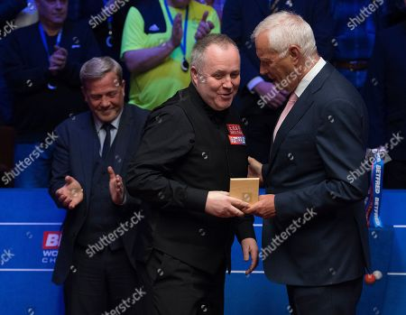 Stock Photo of John Higgins of Scotland receives his runners up prize from Barry Hearn
