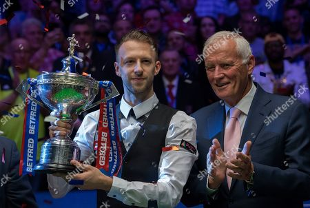 Judd Trump of England celebrates with Barry Hearn after winning the final match