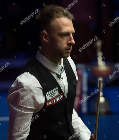 Judd Trump of England at the table during the final match