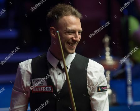 Judd Trump of England smiles during a maximum 147 attempt in the final match