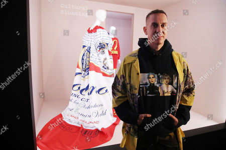 Stock Image of Jeremy Scott poses in front of one of his designs