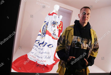 Jeremy Scott poses in front of one of his designs