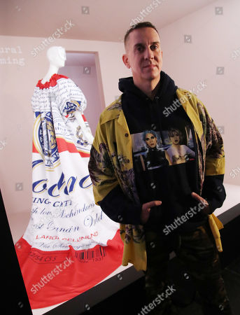 Stock Picture of Jeremy Scott poses in front of one of his designs