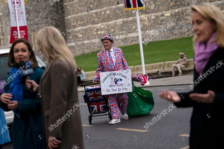 Royal fan Terry Scott poses with a sign at Windsor Castle after the announcement of the birth of a baby boy to Prince Harry, Duke of Sussex and Meghan Duchess of Sussex in Windsor, Britain, 06 May 2019. The Duchess of Sussex gave birth to a son, Buckingham Palace announced. It is the first child of Prince Harry and his wife Meghan.