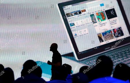 Microsoft CEO Satya Nadella walks past audience members as he delivers the keynote address at Build, the company's annual conference for software developers, in Seattle