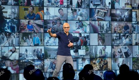Microsoft CEO Satya Nadella waves as he finishes delivering the keynote address at Build, the company's annual conference for software developers, in Seattle