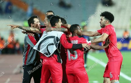 Stock Picture of Al-Duhail's Edmilson Junior Silva with head coach  Rui Faria and teammates after scoring the 1-1 equalizer goal during the AFC Champions League group C soccer match between Esteghlal FC and Al-Duhail SC at the Azadi Stadium in Tehran, Iran, 06 May 2019.