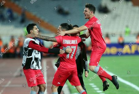 Al-Duhail's Edmilson Junior Silva with head coach  Rui Faria and teammates after scoring the 1-1 equalizer goal during the AFC Champions League group C soccer match between Esteghlal FC and Al-Duhail SC at the Azadi Stadium in Tehran, Iran, 06 May 2019.