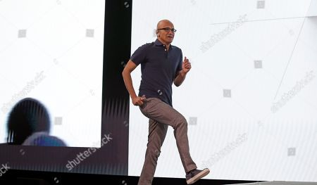 Microsoft CEO Satya Nadella jogs onstage to deliver the keynote address at Build, the company's annual conference for software developers, in Seattle