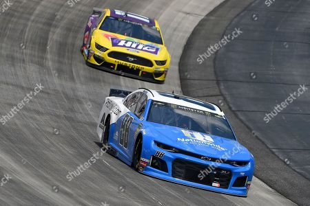 Alex Bowman (88) leads Ricky Stenhouse Jr. (17) during the NASCAR Cup Series auto race, at Dover International Speedway in Dover, Del