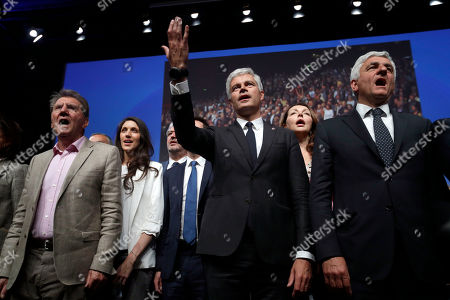 Laurent Wauquiez, center right, president of the Republican Party, Francois-Xavier Bellamy, behind center left, candidate for the European elections, Herve Morin, right, president of France Regions, Valerie Boyer deputy, second right, Guy Tessier deputy, left, sing the national anthem during a campaign meeting in Marseille, southern France, . The European elections will take place from May 23 to May 26
