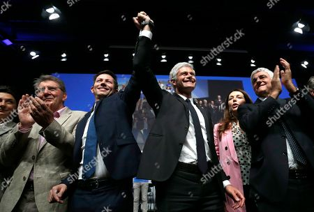 Stock Photo of Laurent Wauquiez, center right, President of the Republican Party, and Francois-Xavier Bellamy, center left, candidate for the European elections, surrounded by Herve Morin, right, President of France Regions, Valerie Boyer deputy, second right, Guy Tessier deputy, left, wave to supporters during a campaign meeting in Marseille, southern France, . The European elections will take place from May 23 to May 26