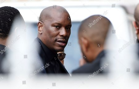 """Tyrese, who was a cast member in director John Singleton's 2001 film """"Baby Boy,"""" arrives at a memorial service for Singleton at Angelus Funeral Home, in Los Angeles. Singleton died on April 29 following a stroke"""