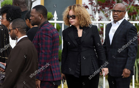 Costume designer Ruth Carter, second from right, arrives at a memorial service for the late film director John Singleton at Angelus Funeral Home, in Los Angeles. Singleton died on April 29 following a stroke