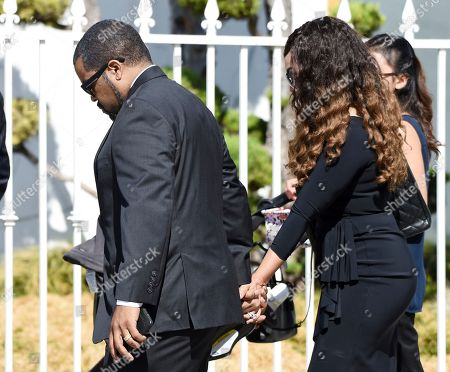 """Actor/rapper Ice Cube, left, a cast member in director John Singleton's 1991 debut film """"Boyz n the Hood,"""" arrives at a memorial service for the late film director John Singleton at Angelus Funeral Home, in Los Angeles. Singleton died on April 29 following a stroke"""