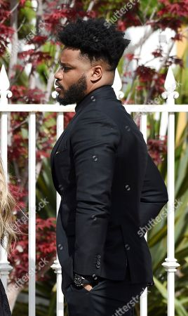 Director Ryan Coogler arrives at a memorial service for the late film director John Singleton at Angelus Funeral Home, in Los Angeles. Singleton died on April 29 following a stroke