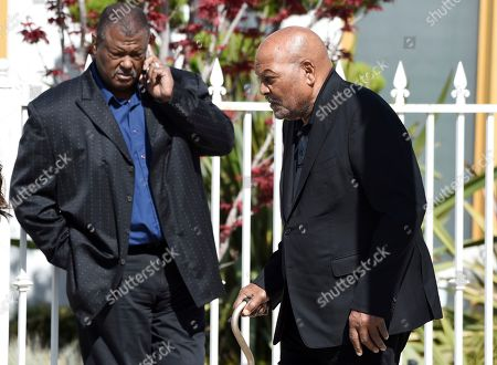 NFL football legend and actor Jim Brown, right, arrives at a memorial service for the late film director John Singleton at Angelus Funeral Home, in Los Angeles. Singleton died on April 29 following a stroke