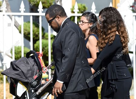 """Actor/rapper Ice Cube, a cast member in director John Singleton's 1991 debut film """"Boyz n the Hood,"""" arrives at a memorial service for Singleton at Angelus Funeral Home, in Los Angeles. Singleton died on April 29 following a stroke"""