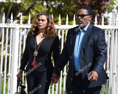 Tina Knowles, Richard Lawson. Tina Knowles, left, and husband Richard Lawson arrive at a memorial service for the late film director John Singleton at Angelus Funeral Home, in Los Angeles. Singleton died on April 29 following a stroke
