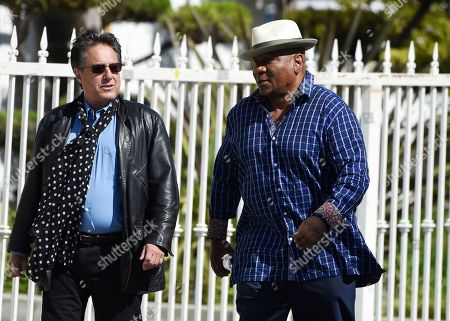 "Actor Ving Rhames, right, a cast member in director John Singleton's 2001 film ""Baby Boy,"" arrives at a memorial service for Singleton at Angelus Funeral Home, in Los Angeles. Singleton died on April 29 following a stroke"