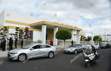 Cars file into the Angelus Funeral Home parking lot for a memorial service for the late film director John Singleton, in Los Angeles. Singleton died on April 29 following a stroke