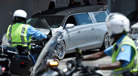 A hearse carrying the casket of film director John Singleton leaves Angelus Funeral Home, after a memorial service in Los Angeles. Singleton died on April 29 following a stroke