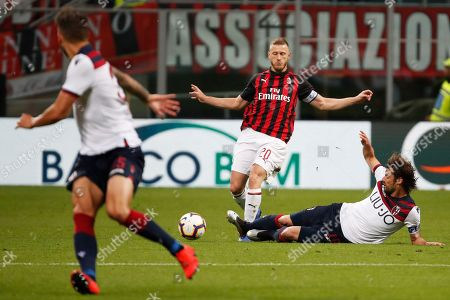 AC Milan's Ignazio Abate, left, vies for the ball with Bologna's Andrea Poli during the Italian Serie A soccer match between AC Milan and Bologna at the San Siro stadium, in Milan, Italy