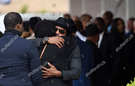 Guests at a memorial service for the late film director John Singleton embrace at Angelus Funeral Home, in Los Angeles. Singleton died on April 29 following a stroke