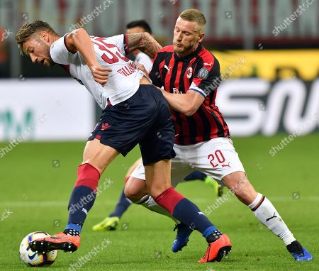 Stock Picture of Bologna's Mitchell Dijks (L) and Milan's Ignazio Abate (R) in action during the Italian Serie A soccer match between AC Milan and Bologna FC at the Giuseppe Meazza stadium in Milan, Italy, 06 May 2019.
