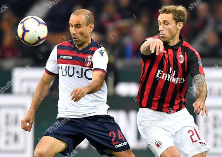 Bologna's Rodrigo Palacio (L) and Milan's Lucas Biglia (R) in action during the Italian Serie A soccer match between AC Milan and Bologna FC at the Giuseppe Meazza stadium in Milan, Italy, 06 May 2019.