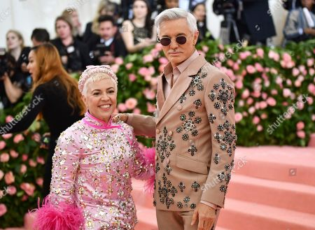 """Catherine Martin, Baz Luhrmann. Catherine Martin, left, and Baz Luhrmann attend The Metropolitan Museum of Art's Costume Institute benefit gala celebrating the opening of the """"Camp: Notes on Fashion"""" exhibition, in New York"""