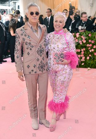 """Baz Luhrmann, Catherine Martin. Baz Luhrmann, left, and Catherine Martin attend The Metropolitan Museum of Art's Costume Institute benefit gala celebrating the opening of the """"Camp: Notes on Fashion"""" exhibition, in New York"""