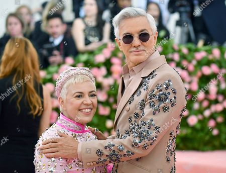 """Baz Luhrmann, Catherine Martin. Baz Luhrmann, right, and Catherine Martin attend The Metropolitan Museum of Art's Costume Institute benefit gala celebrating the opening of the """"Camp: Notes on Fashion"""" exhibition, in New York"""